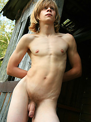 Long-haired twink masturbates in the wood